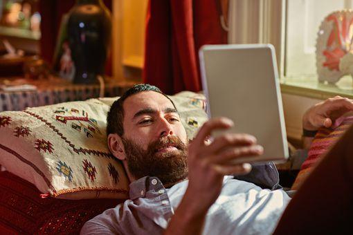 Man relaxing with an ereader