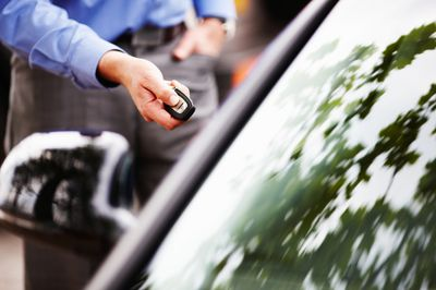 Close-up of man's arm using key fob for car