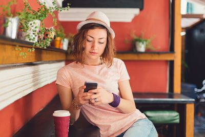 Person using a smartphone in a cafe