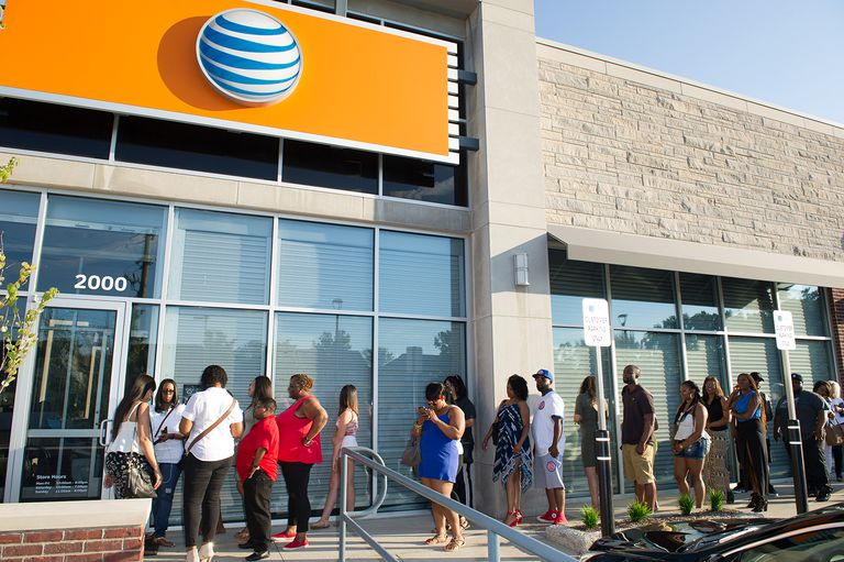 People lined up outside of an AT&T store