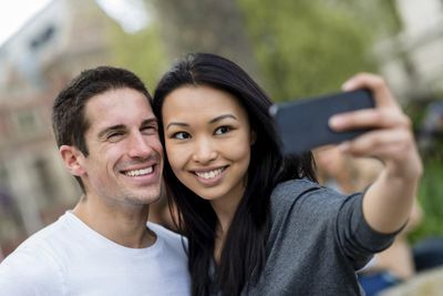 Couple taking a photo with their phone
