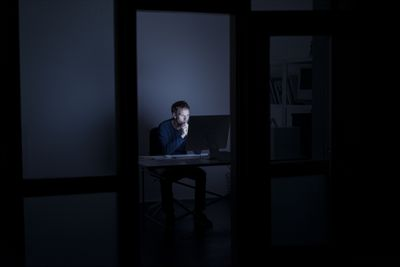 man working on computer late at night