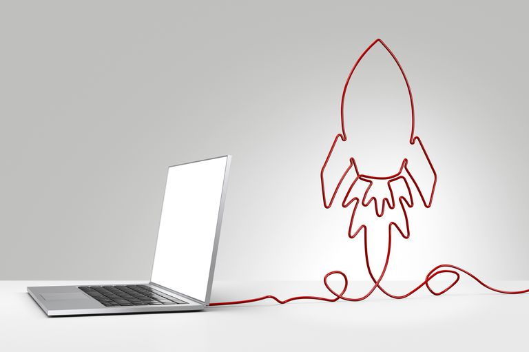 Rocket graphic coming out of laptop