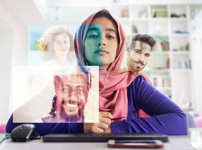 Multicultural video call as seen through the computer screen.