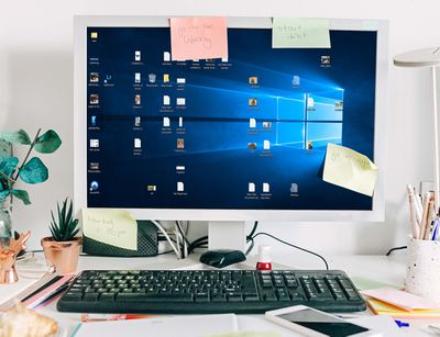 A cluttered Windows 10 desktop in need of hiding the icons.