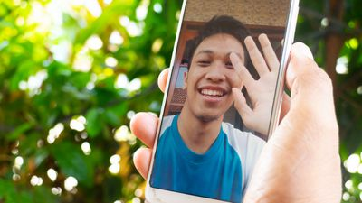 Cropped Hand Doing Video Call With Friend
