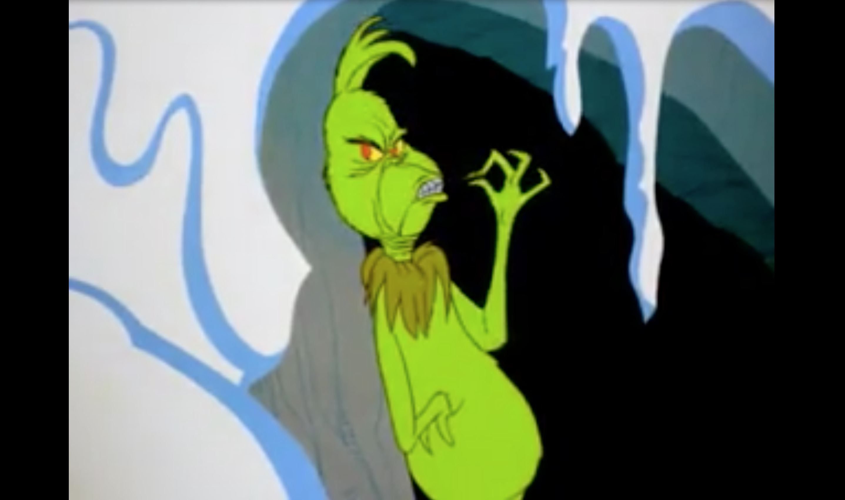 A still image of The Grinch.