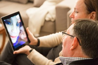 Family with grandparents doing Facetime with iPad