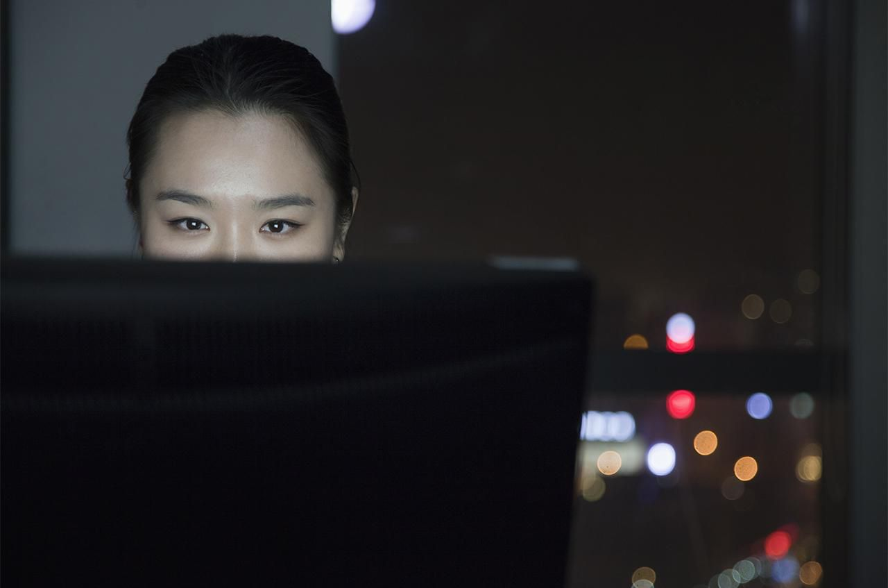 Woman working late on computer