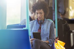 Woman using a Kindle Fire on the train