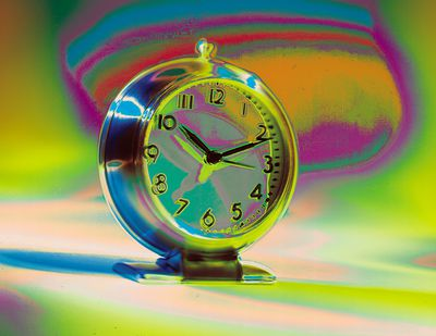 colorful clock for metaphors on time and appointments.it is treated with a posterizezed and multi layered treatment.