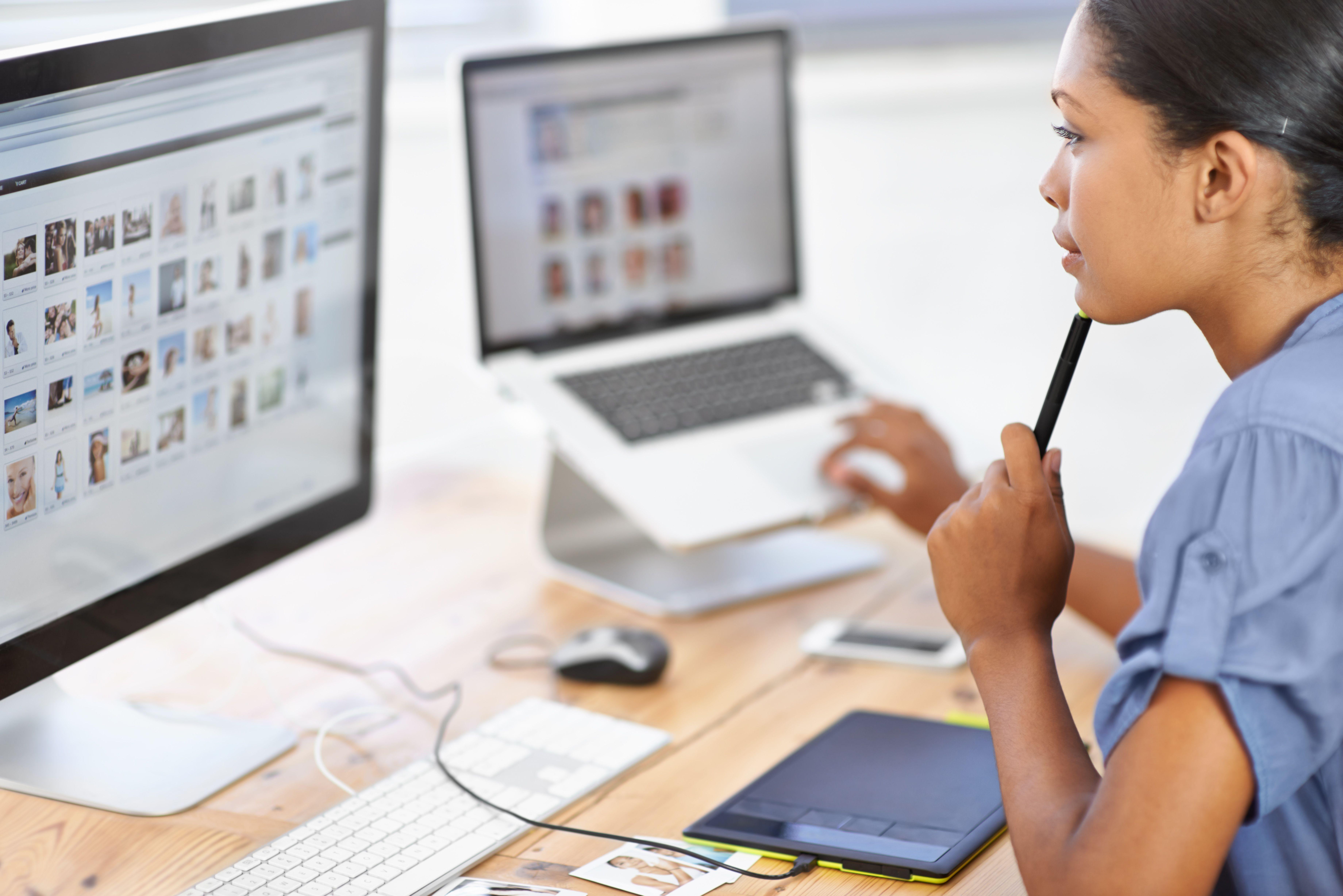 Woman looking at computer screen looking at photos