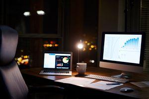 An iMac and MacBook at night not sleeping.