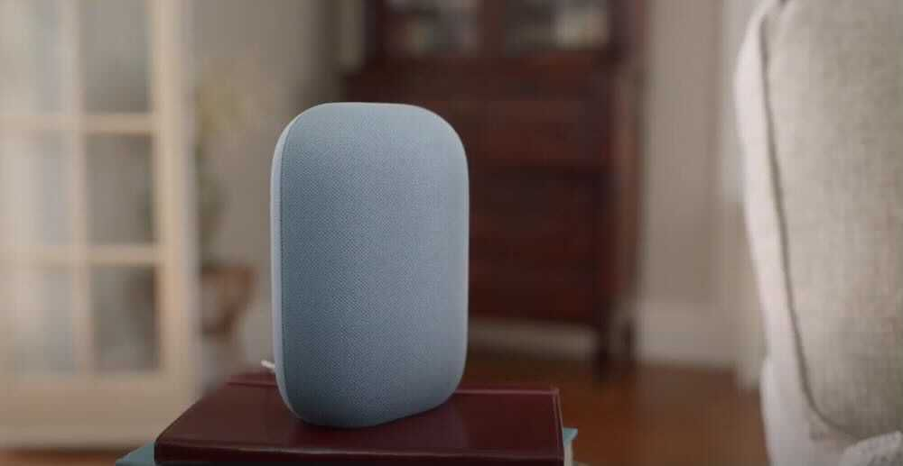 Google's Nest Audio resting next to a couch