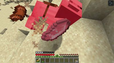 A saddle flying off a pig in Minecraft.