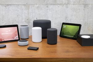 A series of Amazon Echo devices on a table.