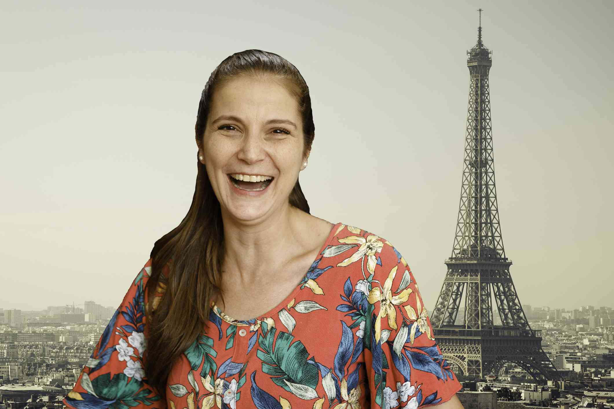 Someone laughing on a video call with a virtual background of the Eifel Tower.