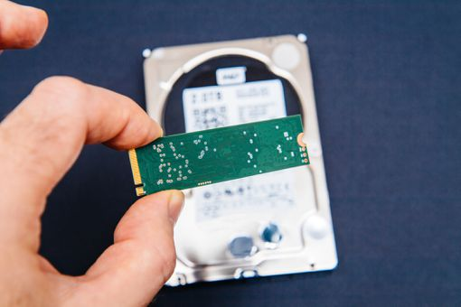 Man holding NVME ssd flash memory disk drive