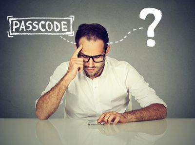 Photo illustration of a man trying to remember his phone's passcode.