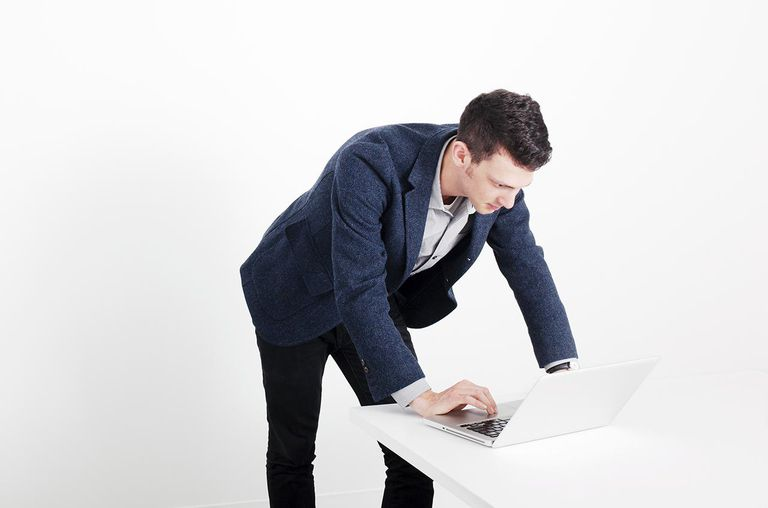 Young Entrepreneur Working On Laptop