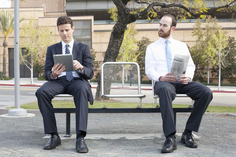 Two businessmen sitting on bench