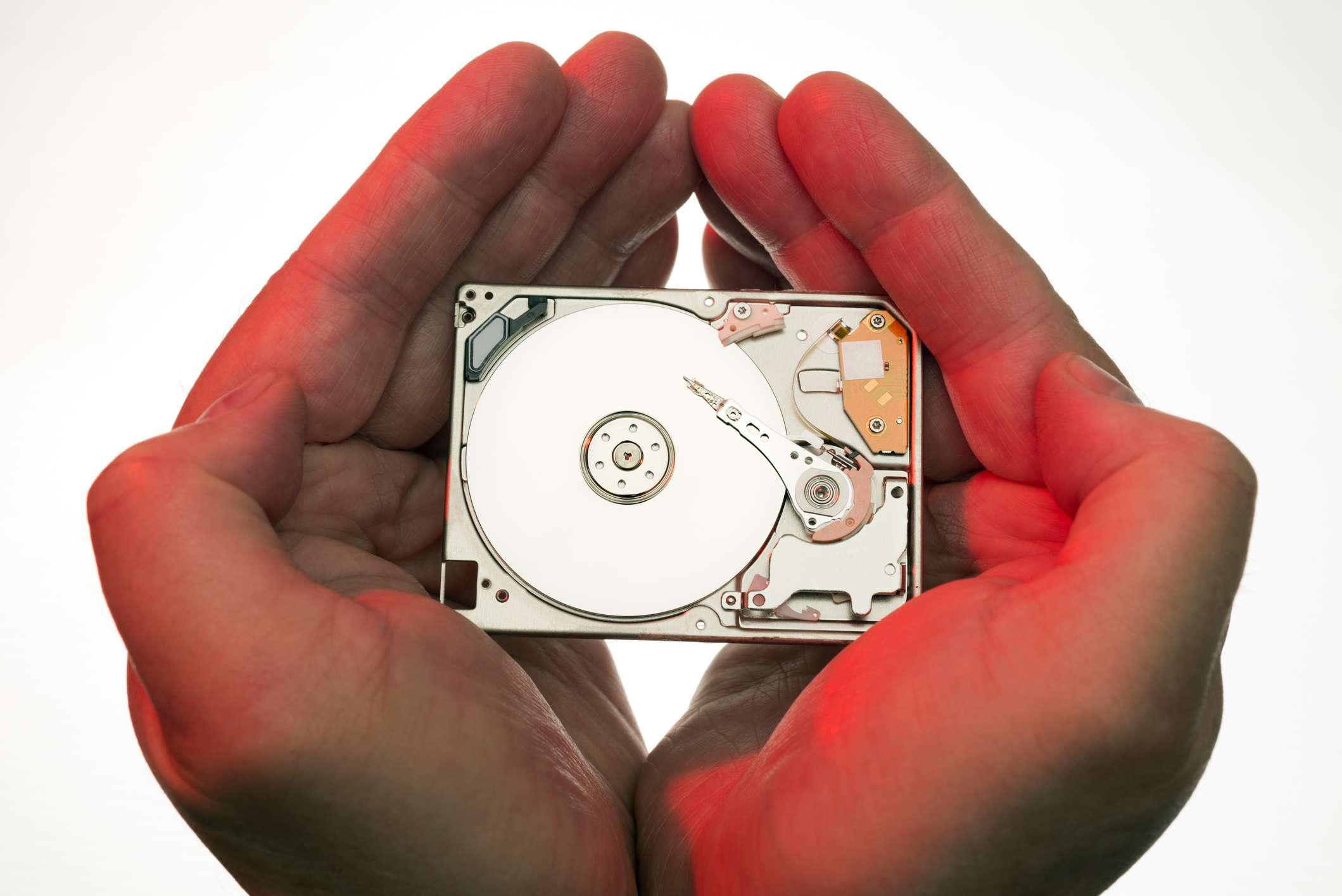 Hands holding computer hard drive