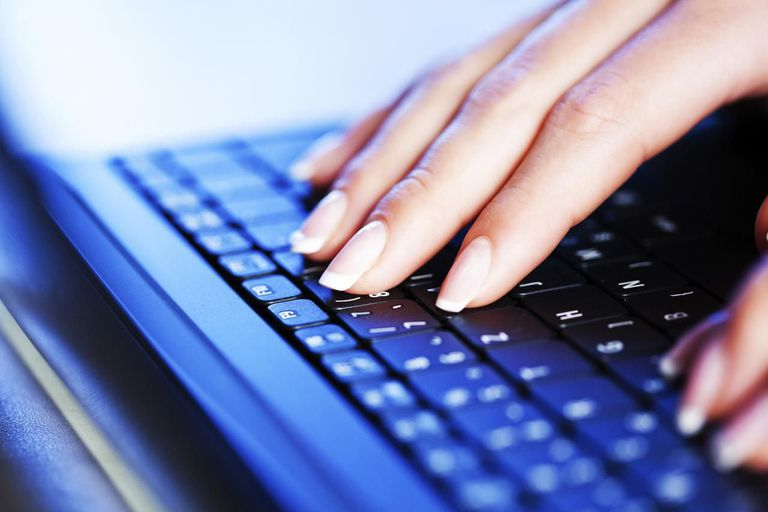 Female hands typing on laptop computer