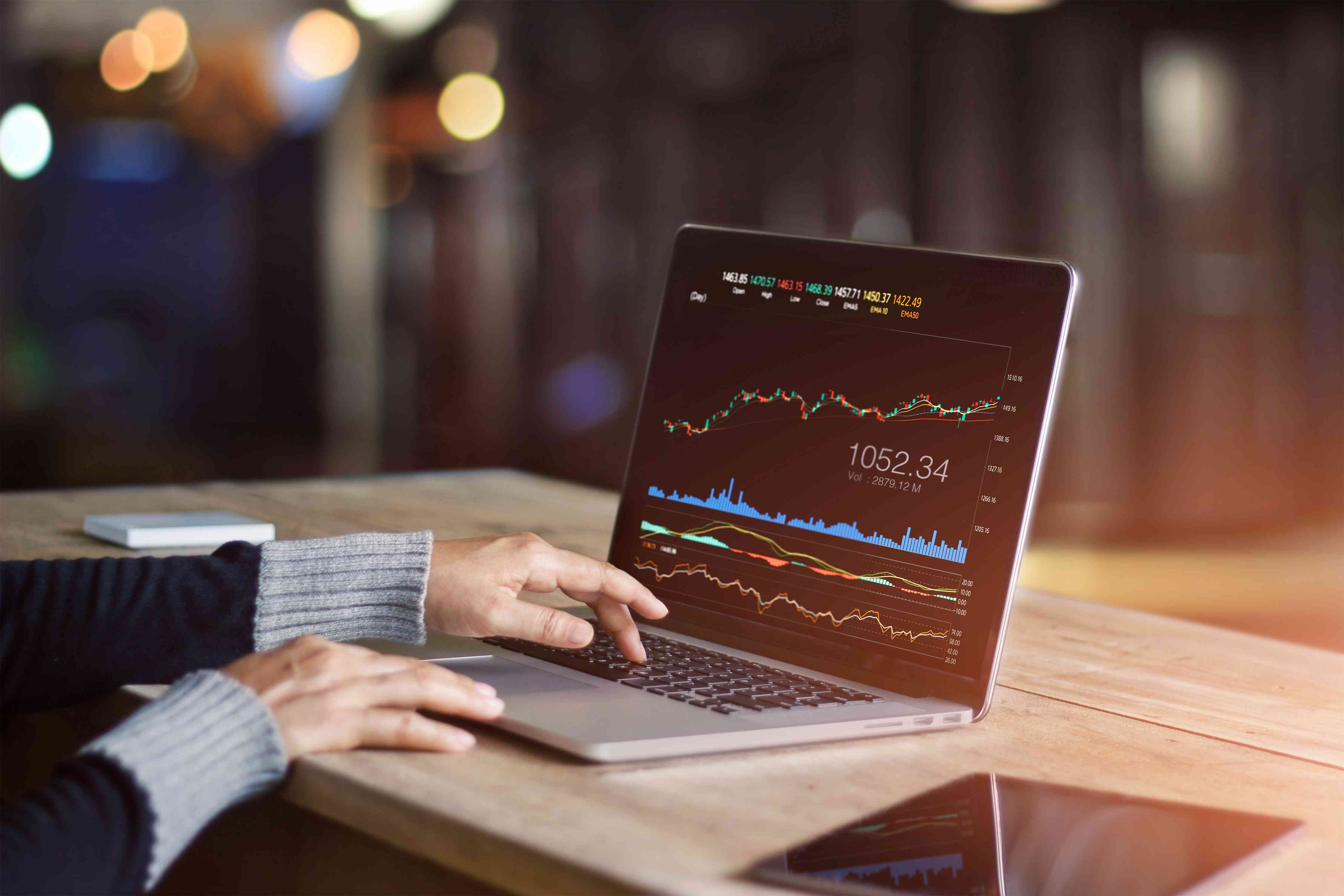 Businessperson using laptop for analyzing data stock market, forex trading graph, stock exchange trading online, financial investment concept. All on laptop screen are design up.