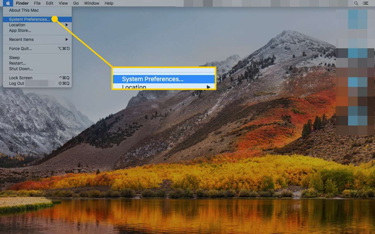 Mac desktop with the System Preferences option highlighted
