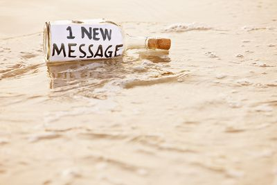 E-mail message from castaway in washed-up bottle on shoreline