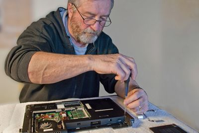 Man fixing computer.