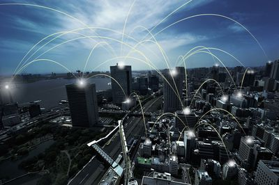 Photography showing arcing lines connecting urban skyscrapers in Tokyo, Japan