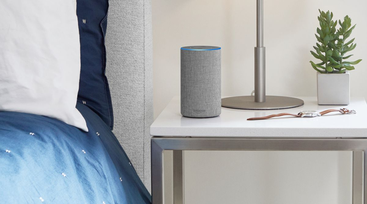 Amazon Echo on night table next to bed