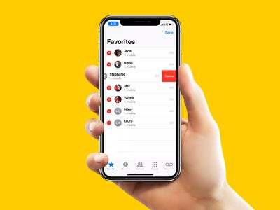 Hand holding an iPhone X with Favorites onscreen