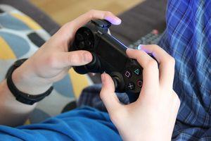 A gamer using a PS2 controller.