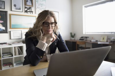 Woman with glasses on laptop