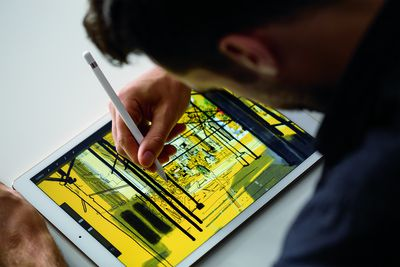Man drawing on an iPad Pro with Apple Pencil