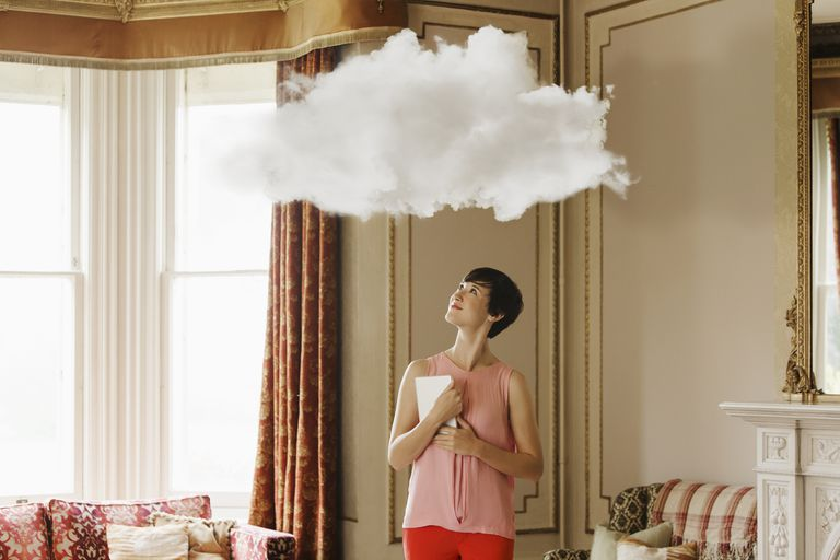 Cloud above woman in living room