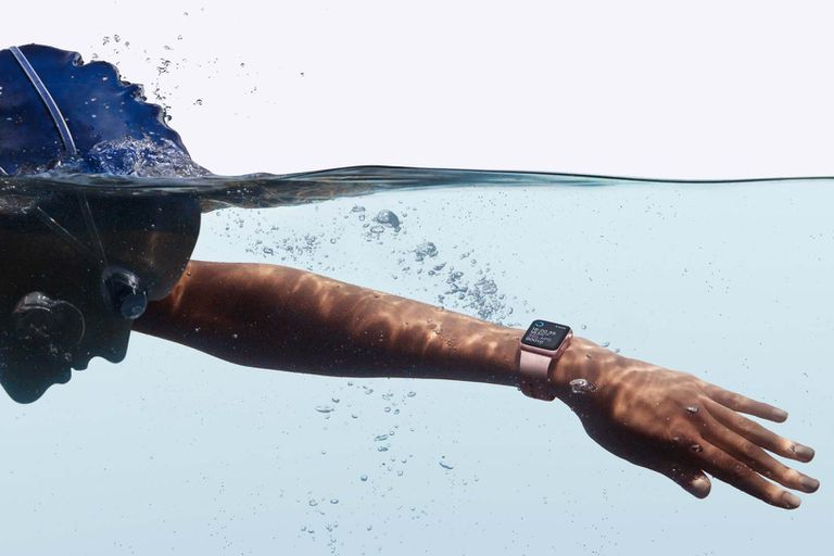 Woman swimming with Apple Watch