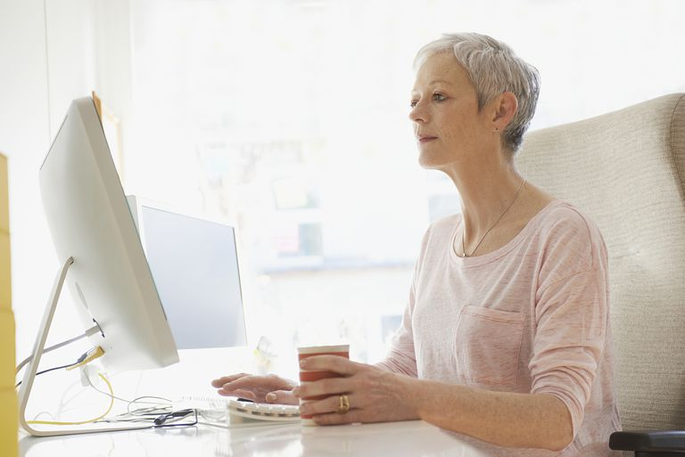 mature woman at home using computer
