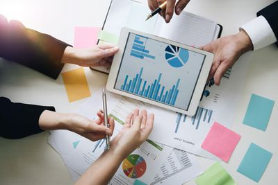 Image of people creating charts and graphs