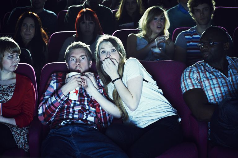 A couple enjoying a movie.