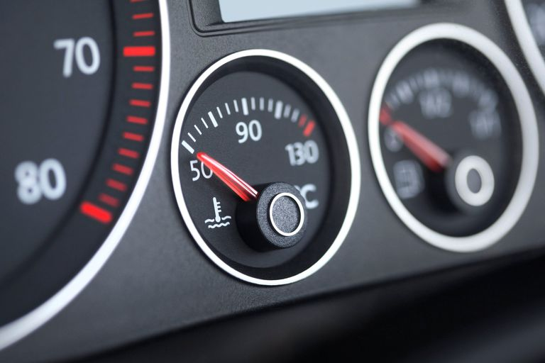 Close up of engine temperature dashboard gauges in car