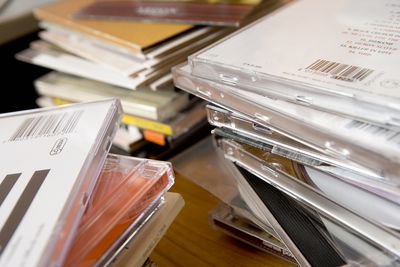 Collection of CDs on a table.