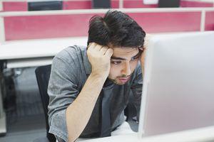 Sad looking person looking at iMac