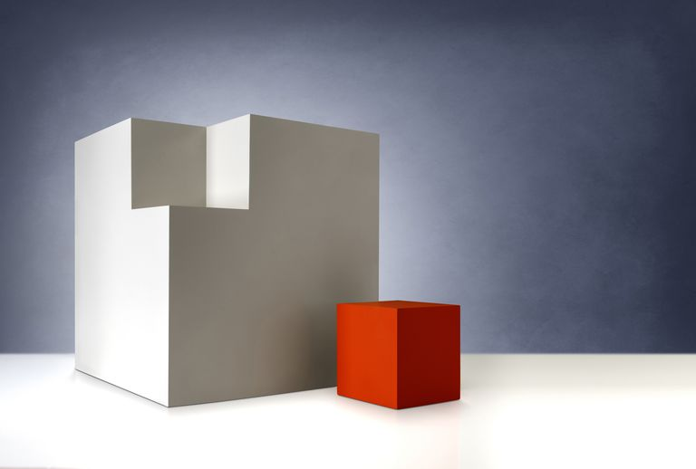 Image of a red cube that fits into a larger beige cube