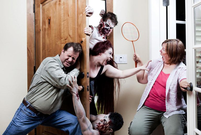 Family trying to close the door while under attack from Zombies