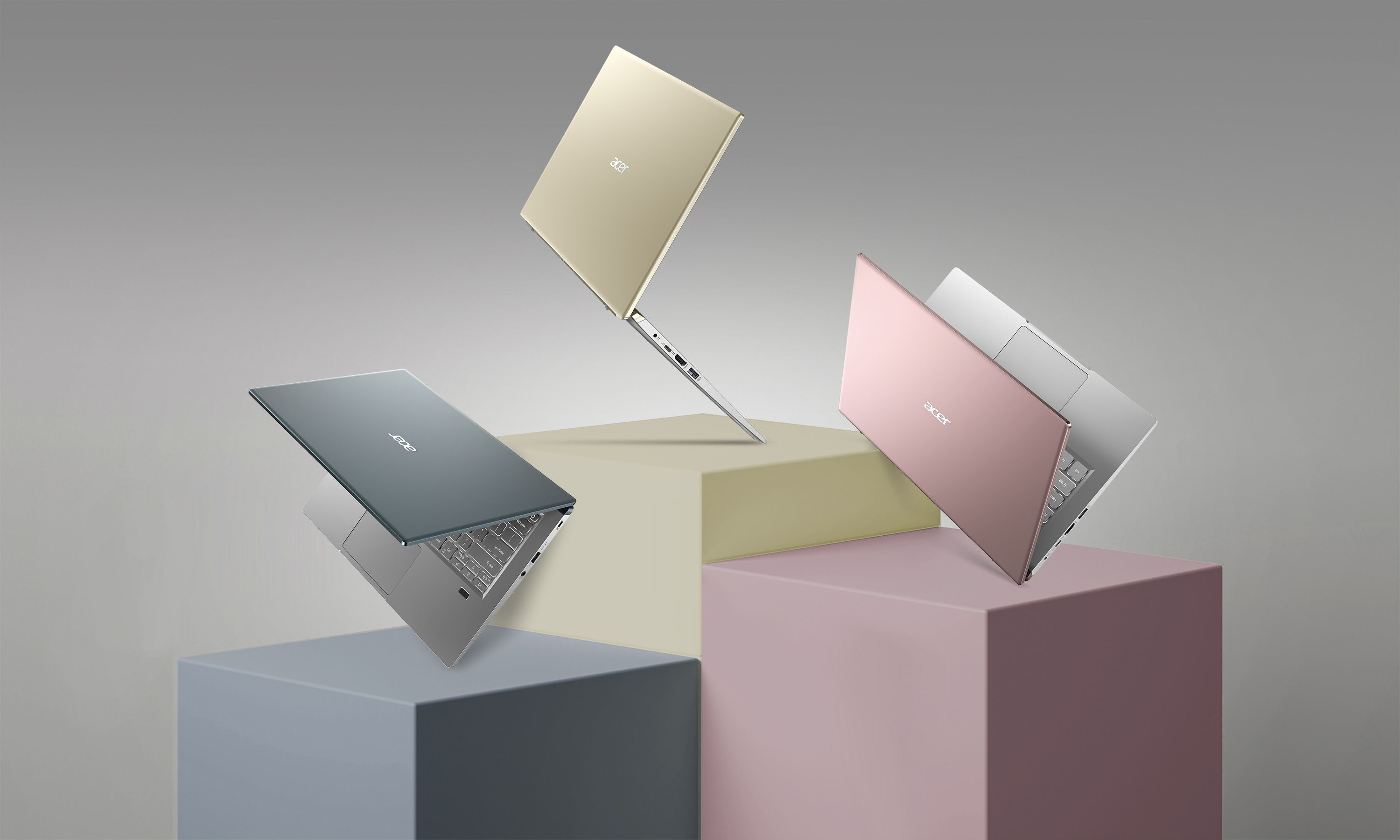 Acer Swift X in rose gold, gold, and grey