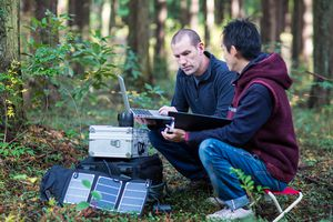 Environmentalists monitor the forest with a solar powered field laboratory
