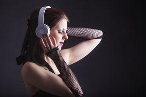 woman listening to music via bluetooth headphones